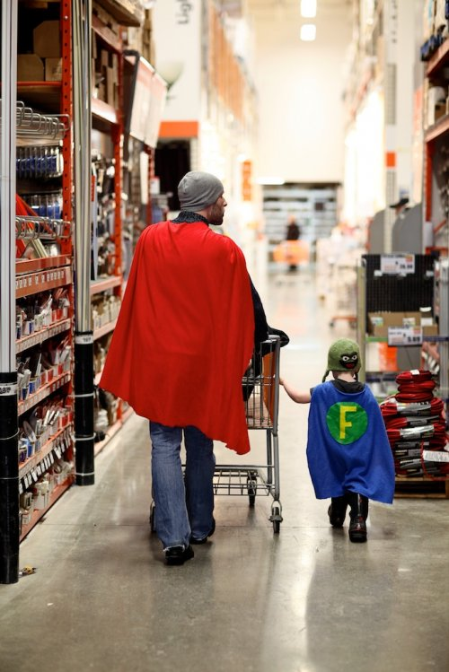 dad and son wearing super hero capes